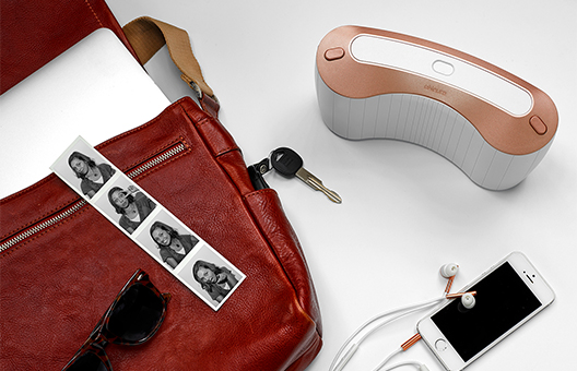eNeura device on desktop with photos, purse, and keys